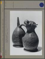Vase double en céramique à anse et étrier