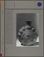 Vase en céramique rouge : sphère aplatie