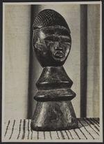 Statuette en bois à double face