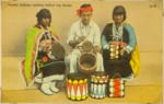 Pueblo Indians making log drums